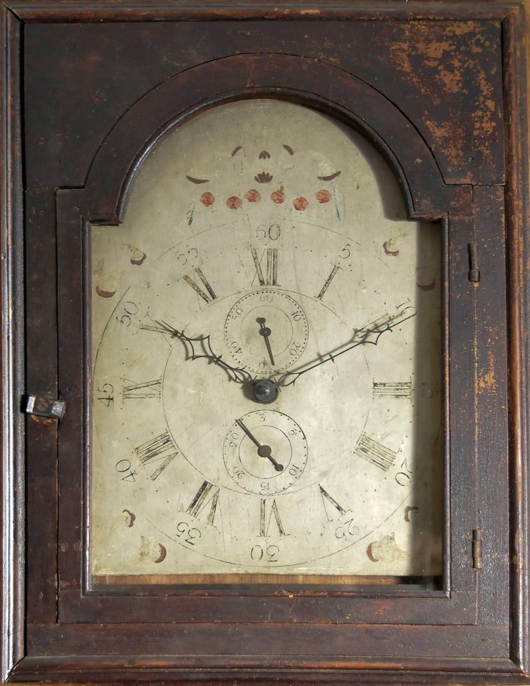 Only a handful examples exist of architectural built-in elements such as this one. A 30-hour clock placed in the recess of a wall with an applied panel, paint decorated as a tall case clock with the facade of a bonnet with painted dial this clock is