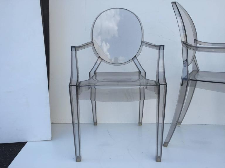 Smoked Lucite individual Philippe Starck or as set of three-arm Louis Ghost and pair of side Victoria Ghost chairs by Kartell available individually. Armchairs measures: D 21.5 H 36.75 W 19 S 19 A 27 all 3 39.25 side chairs: D 19.25 W 15.25 H 35.75