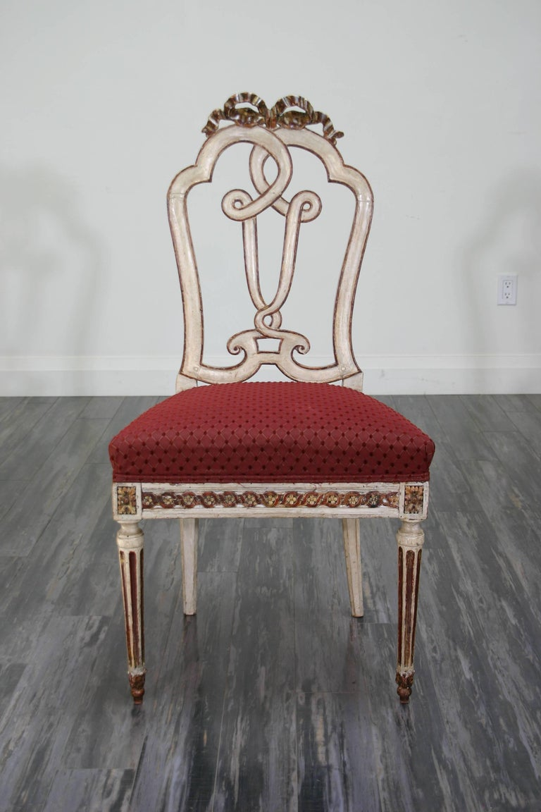 A set of ten 18th century Continental painted and parcel-gilt dining chairs.