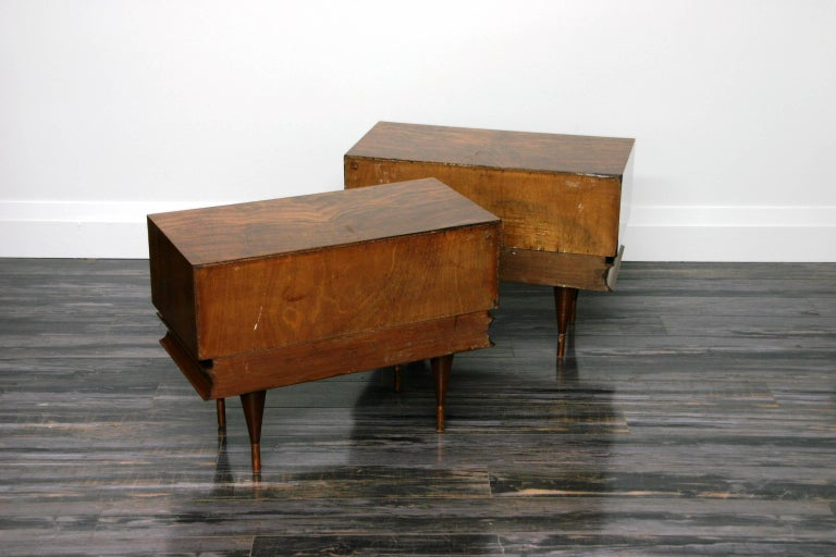 Unique pair of Gio Ponti style Circassia walnut veneered low chest end tables Circassia walnut is a type of grain pattern commonly found in Walnut with swirls and curves in shades of brown or with occasional black streaks, used for veneer and