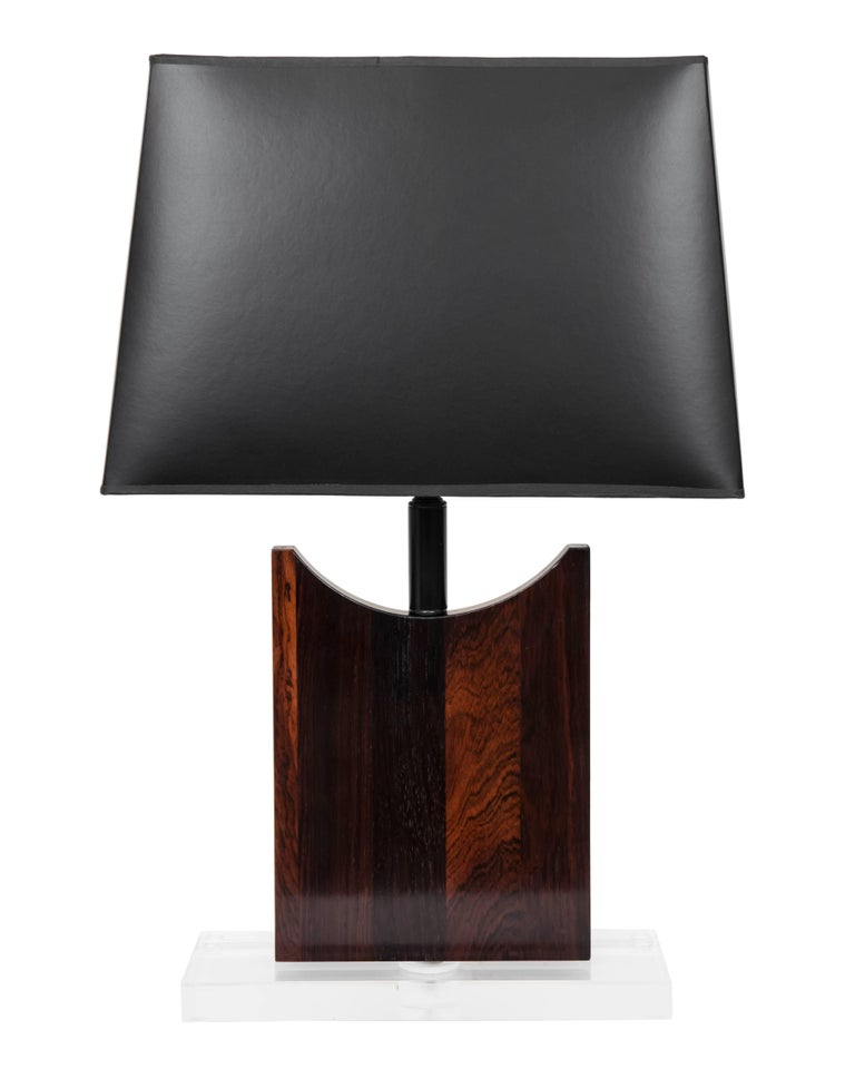 A rich and special pair of custom designed lamps made from vintage wood bases mounted to a Lucite base. New wiring, socket and black shades. White shades also an option.