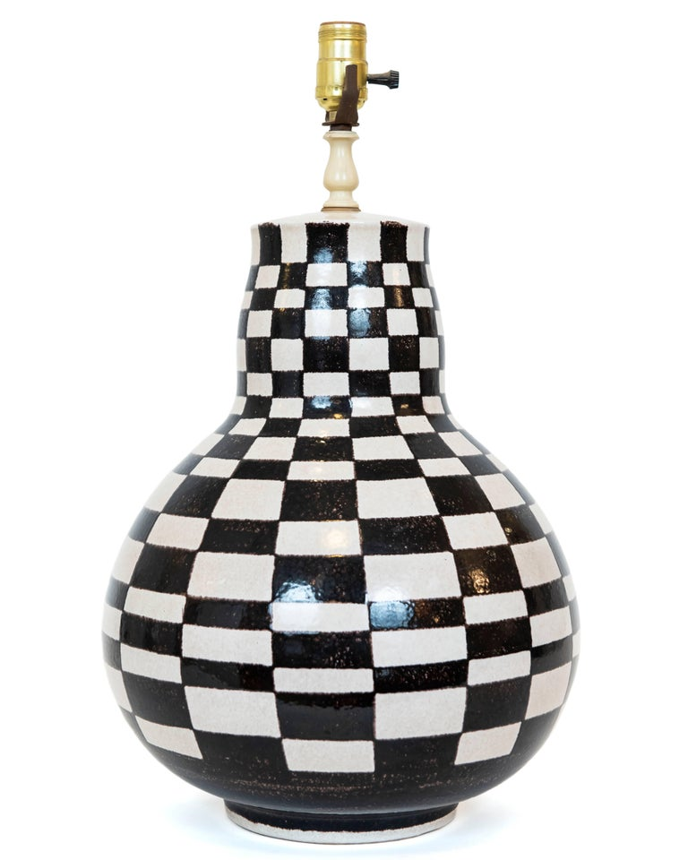 I love the look of this lamp! Black and white checkerboard pattern hand done in Italy over a gourd shaped base. Fun, stylish and unique! New shade optional. Rewired. Measures: Top of the shade height is 28