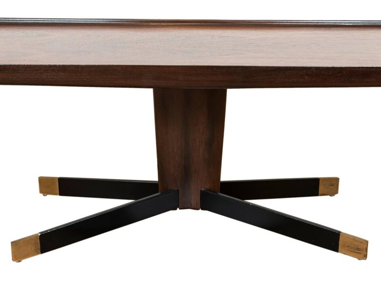 This unique and cool vintage wood coffee table with a richly grained walnut top, leather clad splayed legs with brass feet is ideal for the urbanite or cottager looking for a stylish and functional midcentury piece.