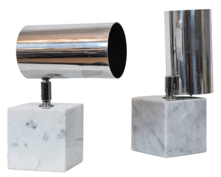 A great pair of vintage up lights with adjustable chrome shade that moves up and down and pivots atop of a Carrara marble base. Medium base socket that can use a LED or a halogen bulb.