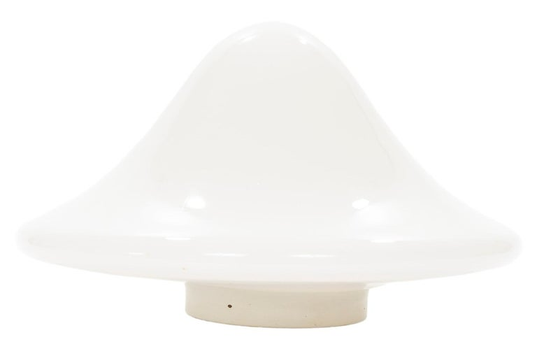 A pair of beautifully stylish vintage mushroom shaped Murano glass lamps in opaque white with a painted white metal supporting base housing a single socket. The lamps have their original labels Vetri Murano and De Majo Murano Venezia attached to the