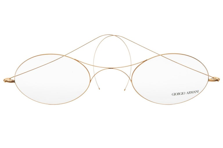 These fun and fabulous Classic vintage Armani frame glasses were probably made for promotional or store display purposes. The giant frame is in a gold colored metal while the lenses are acrylic and imprinted with Giorgio Armani in bold black
