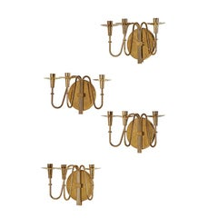Elegant Set of 4  Polished Brass Sconces by Tommi Parzinger