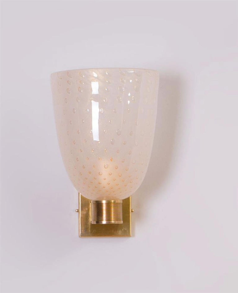 Modernist pair of brass mounted Murano glass sconces, Italy, circa 1970.  Measures: H 13.5, W 7, D 8 in.    $4800.00.