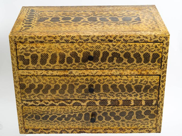 Python skin covered chest of drawers set on later base. Provenance: Collection of Vincent Petragnani. Senior designer of Ethan Allen.
