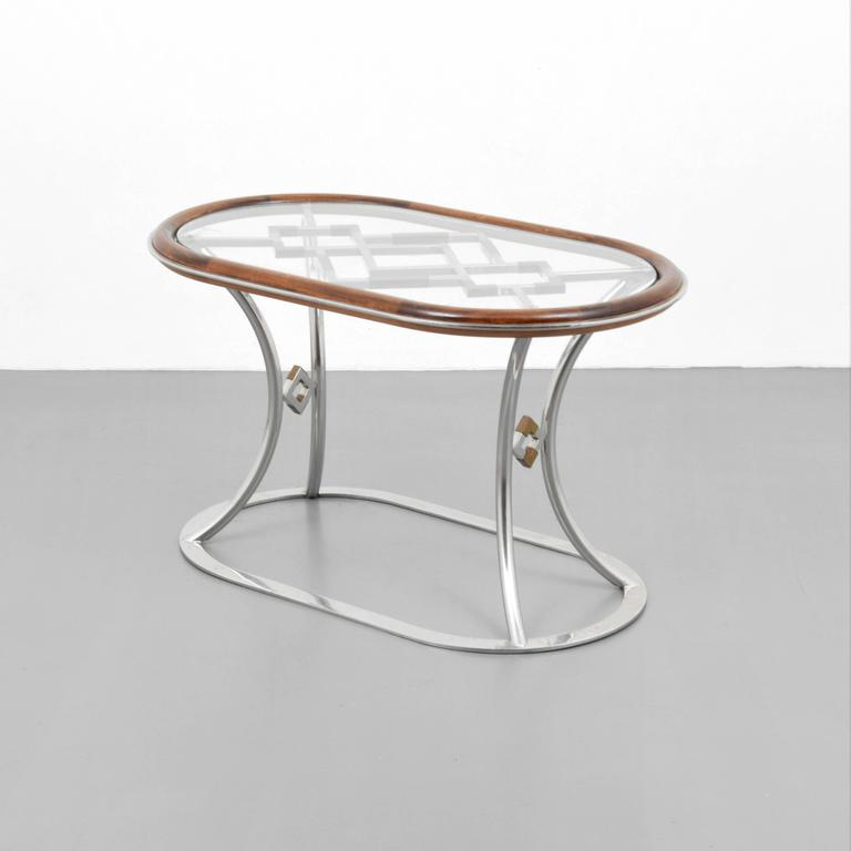 Stylish steel and brass side tables by Alain Delon for Maison Jansen.
