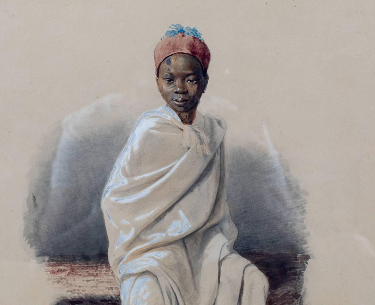 Orientalist watercolor of an Arab boy on an oriental rug. Inscribed in the back the former owner of the painting: