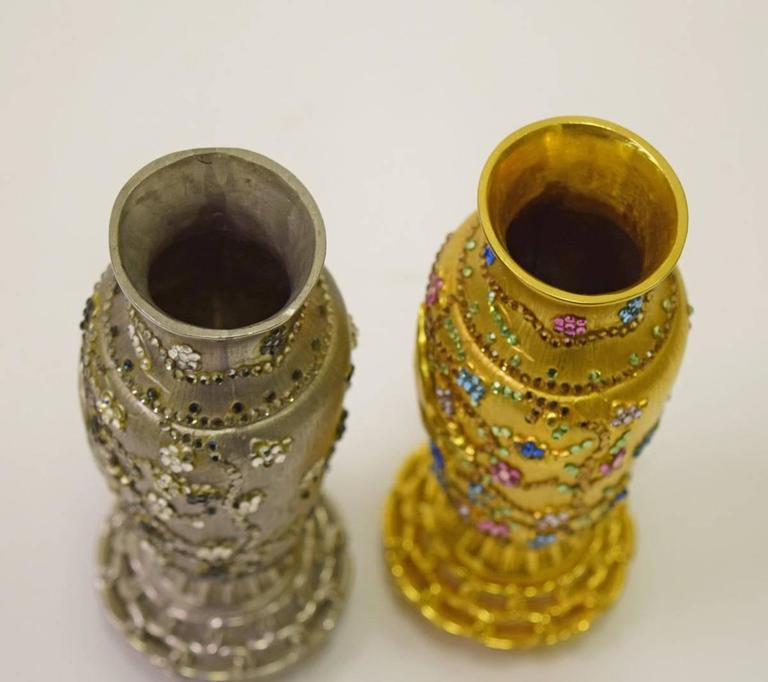 Awesome and unique vintage Judith Leiber Asian holiday vases, beautifully decorated with bird and flower motifs and adorned with multicolored crystals. The vases measure 5.75