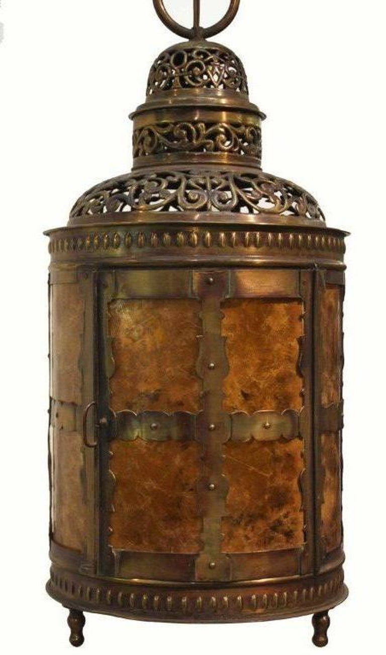Arts and Crafts cylindrical hand pierced brass lantern with three mica panels and mica bottom; a door opens to the side.