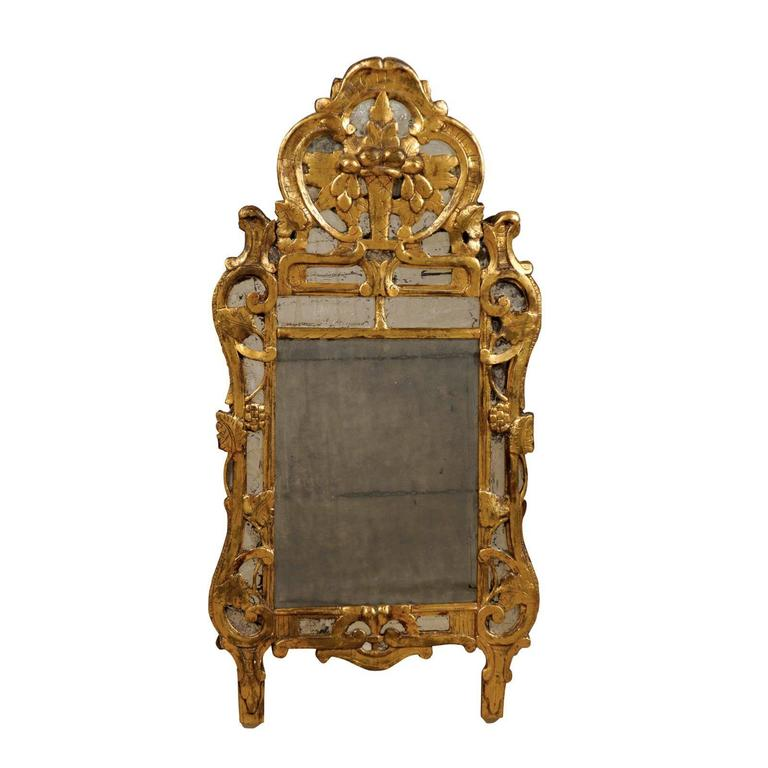 A french rococo style giltwood mirror from the early 19th for French rococo style