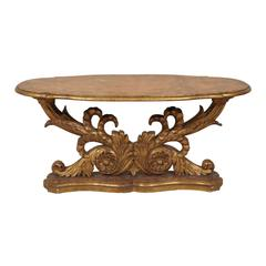 An Italian Mid 19th Century Giltwood Oval Coffee Table with Faux Marble Top