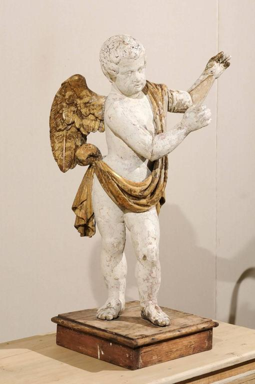 18th Century and Earlier Italian 18th Century Carved Angel with Gilded Wings and Sash Raised on Wood Base For Sale