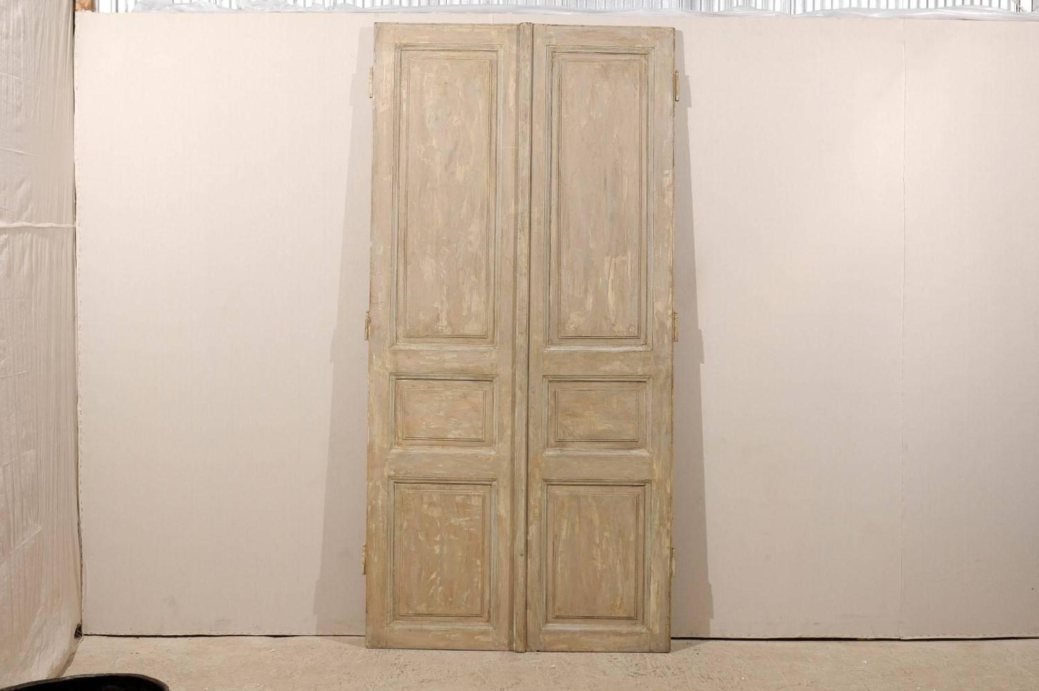 Pair of tall french brown wooden doors with grey and cream for Cream french doors