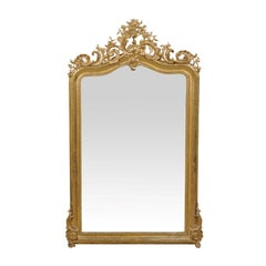 French Rococo Style Gilt Wood Mirror with Ornately Carved Crest