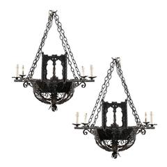 A Pair of Forged Iron Chandeliers, Basket-Shaped with Foliage Motifs