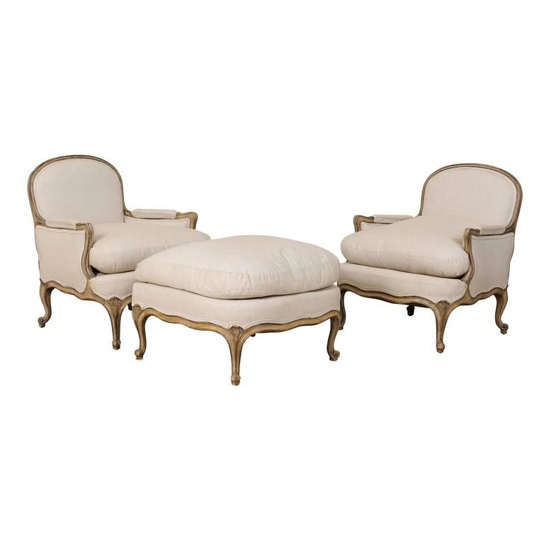 Three-Piece Set of French Bergères Chair Pair with Pouf / Ottoman, Neutral Tones 1