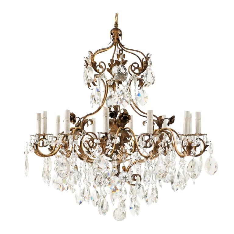 Italian Twelve Light Crystal And Iron In Painted Gold Finish Ornate Chandelier