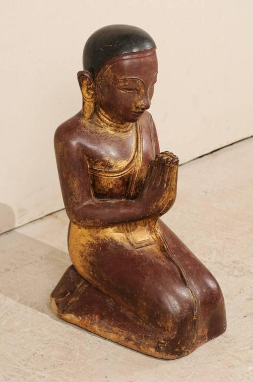 A 19th century Burmese Buddha figure. This Buddha figure of hand-carved sandstone originated in Burma, now Myanmar, during the 19th century, though quite possibly the late 18th century. The carved sandstone was finished in a dry lacquer and gilt,