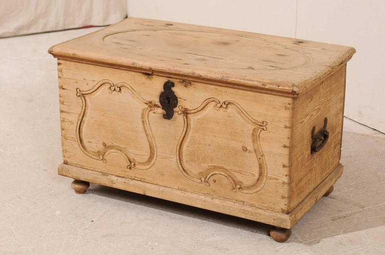 Swedish 19th Century Pine Wood Coffer or Trunk with Shield-Like Carvings on the Front For Sale