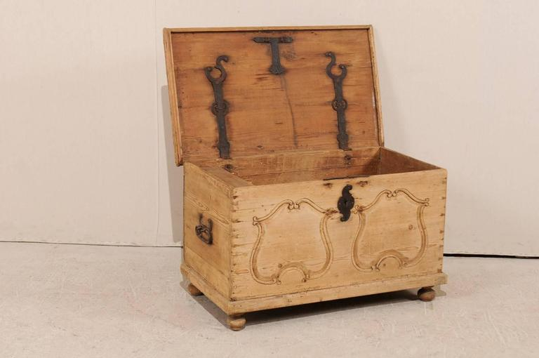Metal 19th Century Pine Wood Coffer or Trunk with Shield-Like Carvings on the Front For Sale