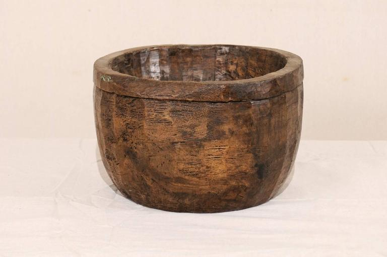 A vintage Naga wood bowl. This beautifully Primitive style bowl has been carved from a single piece of wood. These bowls were originally used in kitchens of the Naga people for various food oriented activities including storing and cooking. The Naga