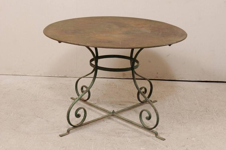 Painted French Mid-20th Century Round Patio Dining Table with Scrolled Legs and Patina For Sale