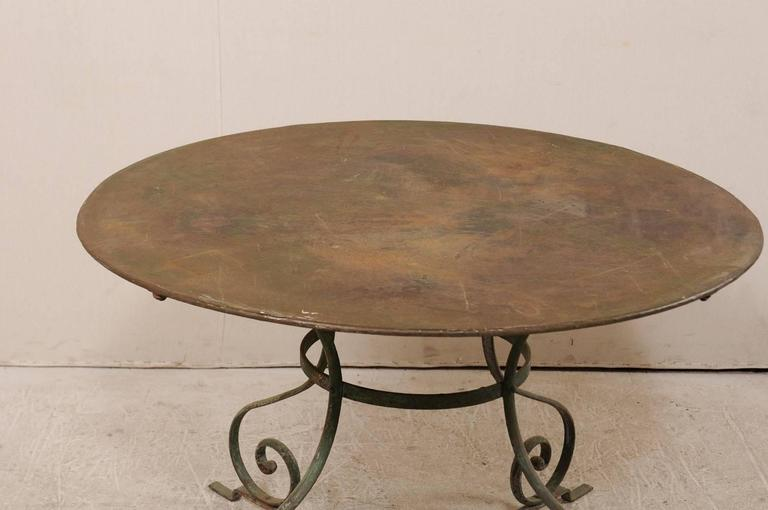 French Mid-20th Century Round Patio Dining Table with Scrolled Legs and Patina In Good Condition For Sale In Atlanta, GA