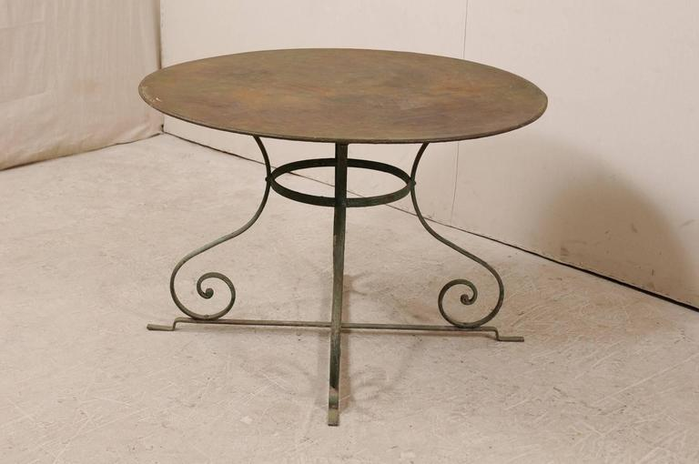 Metal French Mid-20th Century Round Patio Dining Table with Scrolled Legs and Patina For Sale