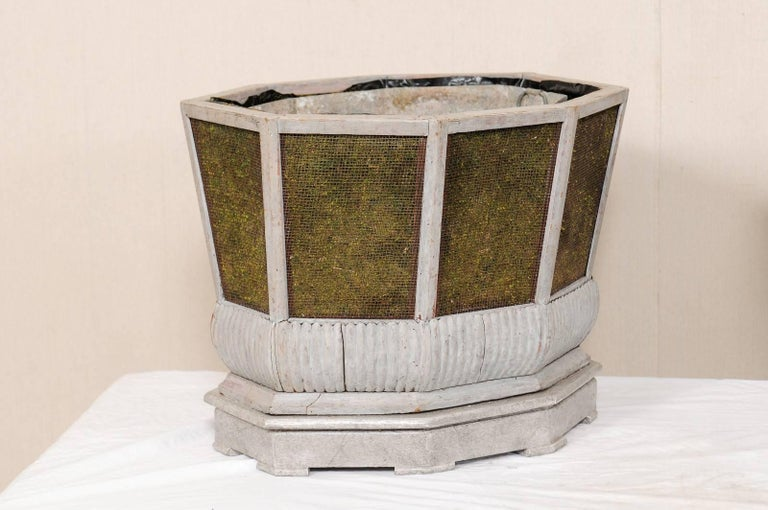 A very unique pair of Swedish planters, circa 1920s. This pair of antique Swedish planters have removable zinc liners (please refer to images for more detail) and have been constructed of painted wood and wire. The sides feature wired sections which