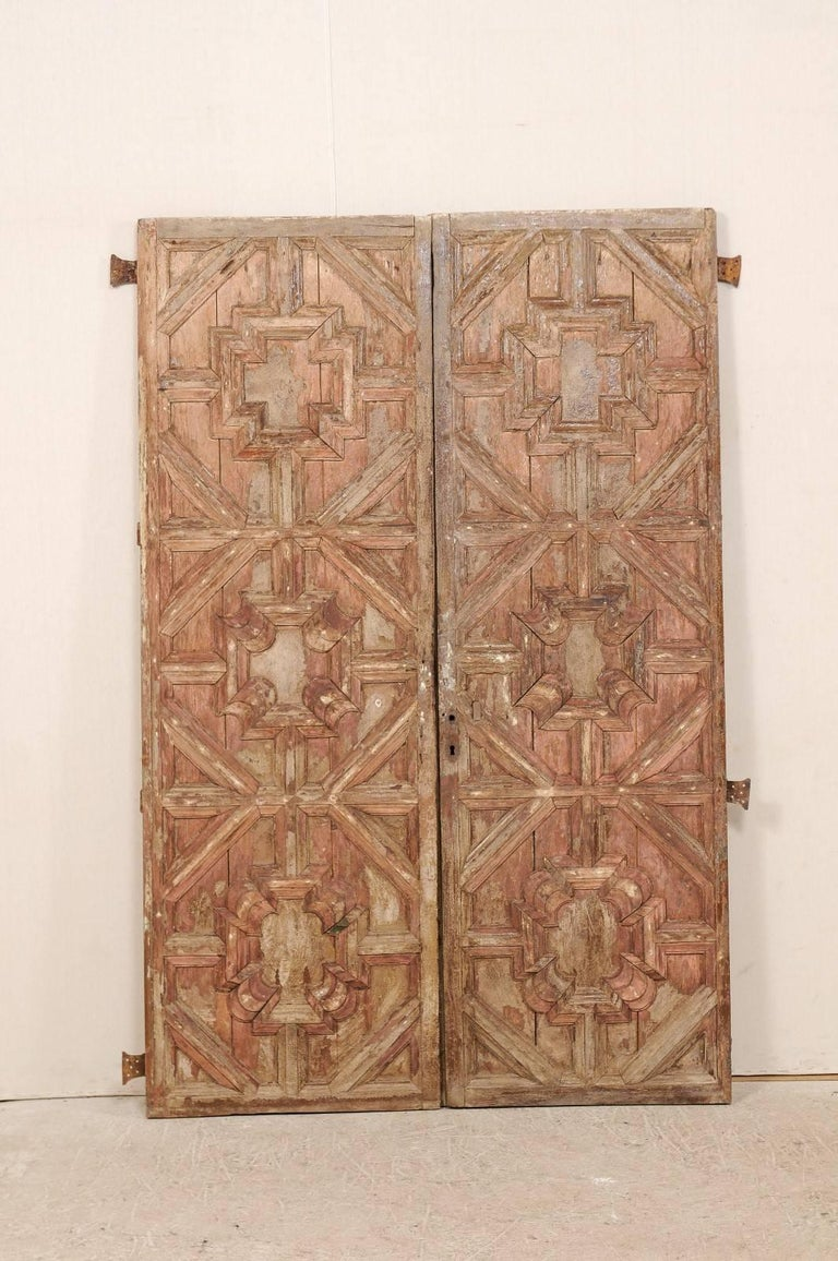 A pair of 18th century Spanish wood carved doors. This pair of antique  Spanish doors - Pair Of 18th Century Spanish Wood Doors With Original Finish At 1stdibs
