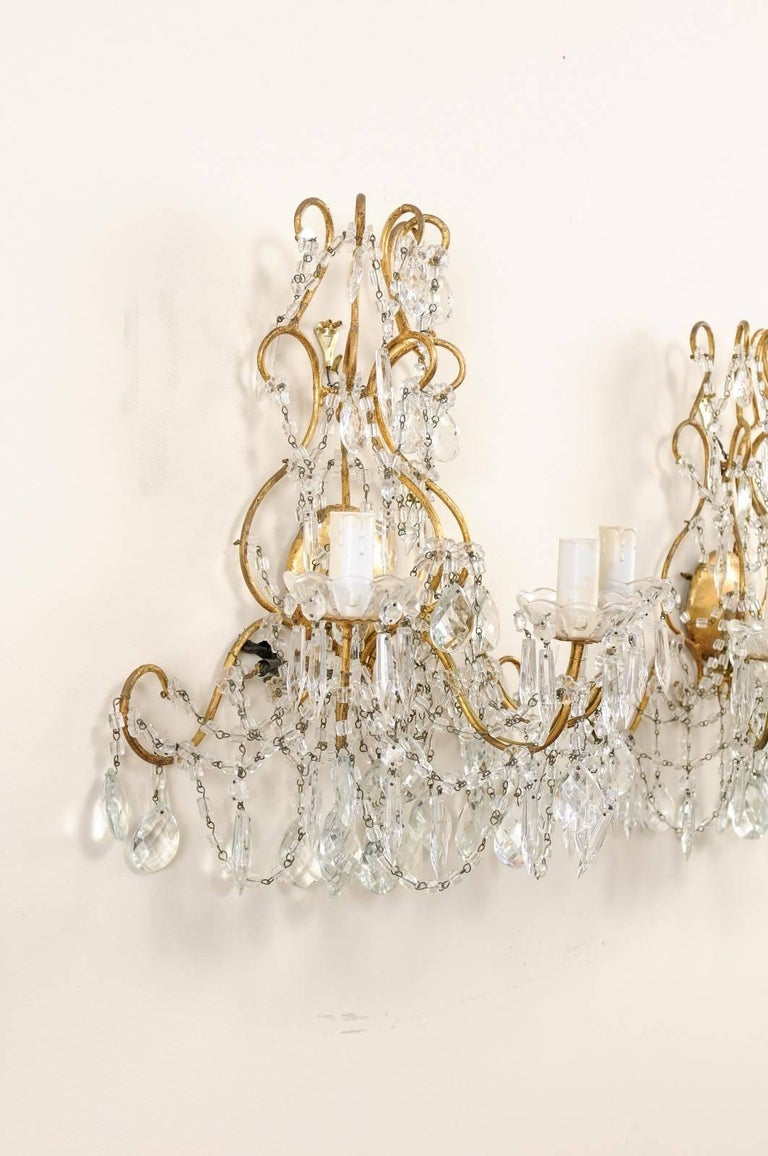 20th Century Italian Pair of Ornately Decorated Crystal & Gilded Metal Three-Light Sconces For Sale
