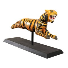 A Whimsical Merry-go-round Tiger of Carved-Wood with Orange and Black Stripes