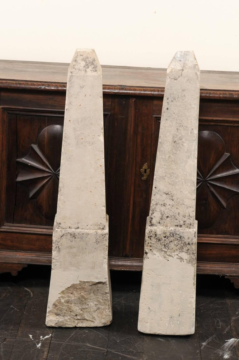 Pair of 19th century French stone obelisks, property markers. This pair of antique French property markers have each been hand cut from a single piece of limestone and have exquisite obelisk shapes. They have wonderful age and patina throughout,