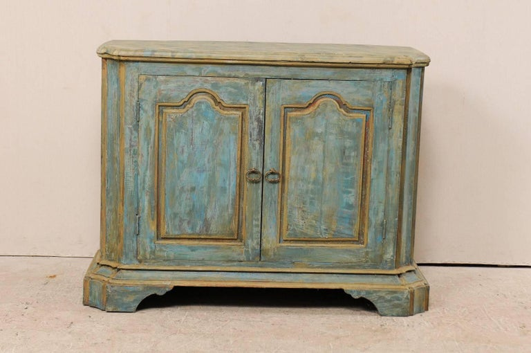 A custom American two-door painted wood buffet console. This vintage Italian style custom buffet cabinet has been made of old reclaimed doors and old wood. This cabinet features two doors, concave and canted side posts (with top buffet top carved to
