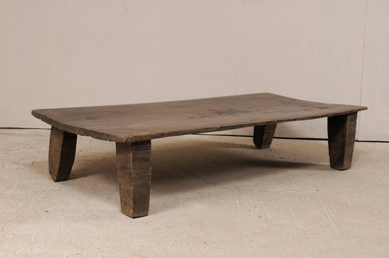 A primitive wood Naga coffee table from the early 20th century. This wooden bed from the Naga tribes of Nagaland, North East India has been carved out of a single log and would make for a great coffee table and conversational piece. Very nice rustic