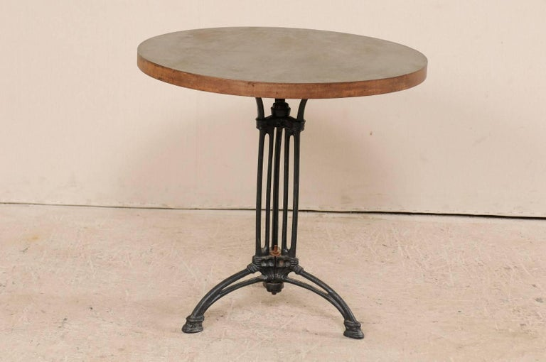 Patinated French Iron Bistro Table with Early 19th Century Iron Base, Indoor/Outdoor For Sale