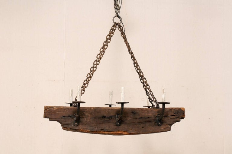 French Vintage Midcentury Rustic Wood Beam Chandelier with Six Forged Iron Arms For Sale 1