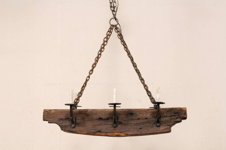 French Vintage Midcentury Rustic Wood Beam Chandelier with Six Forged Iron Arms For Sale 5