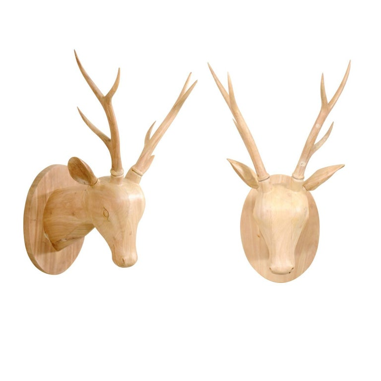 Pair of Carved and Bleached Tropical Hardwood Deer Heads with Oval Back-Plates