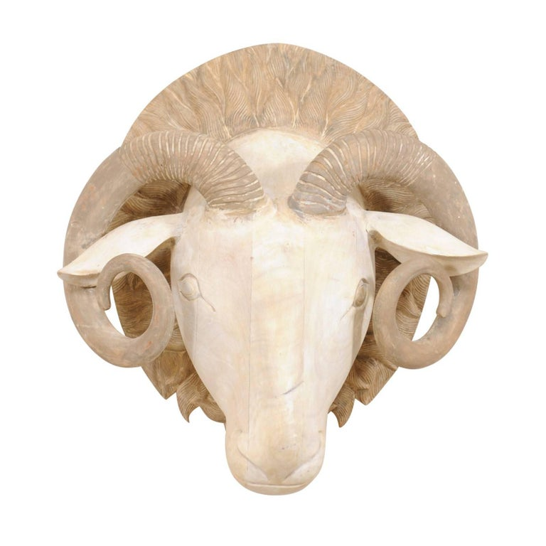 Carved and Painted Wood Ram's Head Wall-Mounted Sculpture