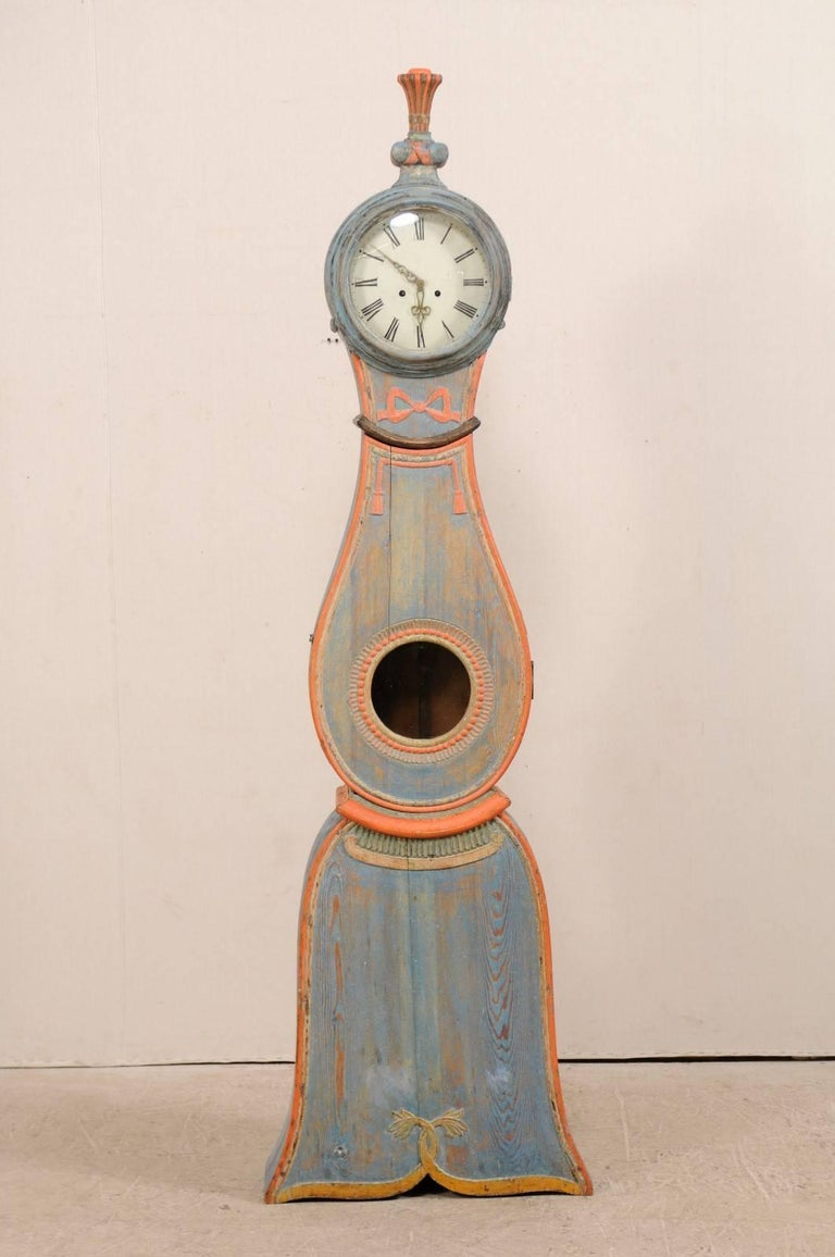 Swedish th century wood floor clock with whimsical
