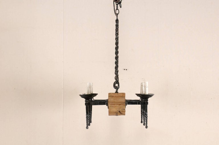 French Vintage Six-Light Wood and Ornate Iron Chandelier with Torch Style Arms For Sale 1