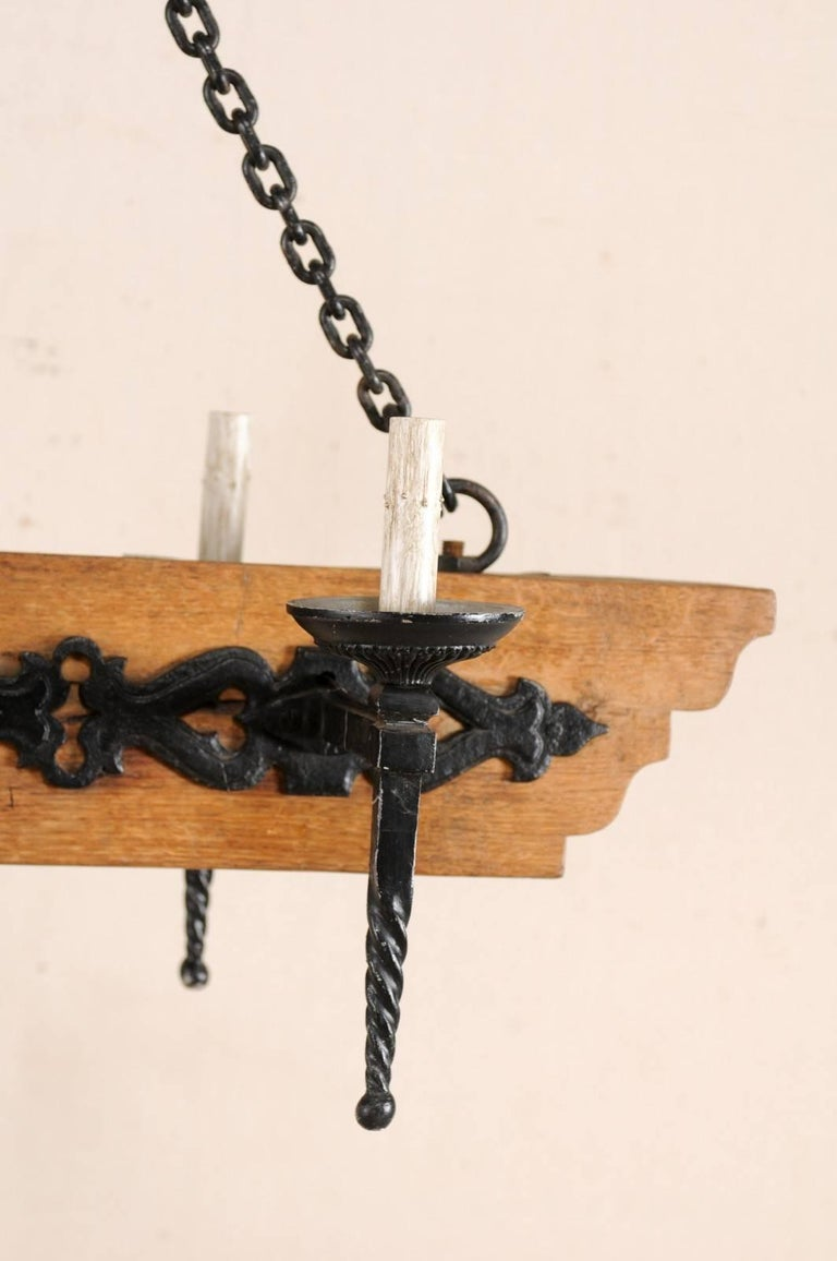 French Vintage Six-Light Wood and Ornate Iron Chandelier with Torch Style Arms For Sale 4