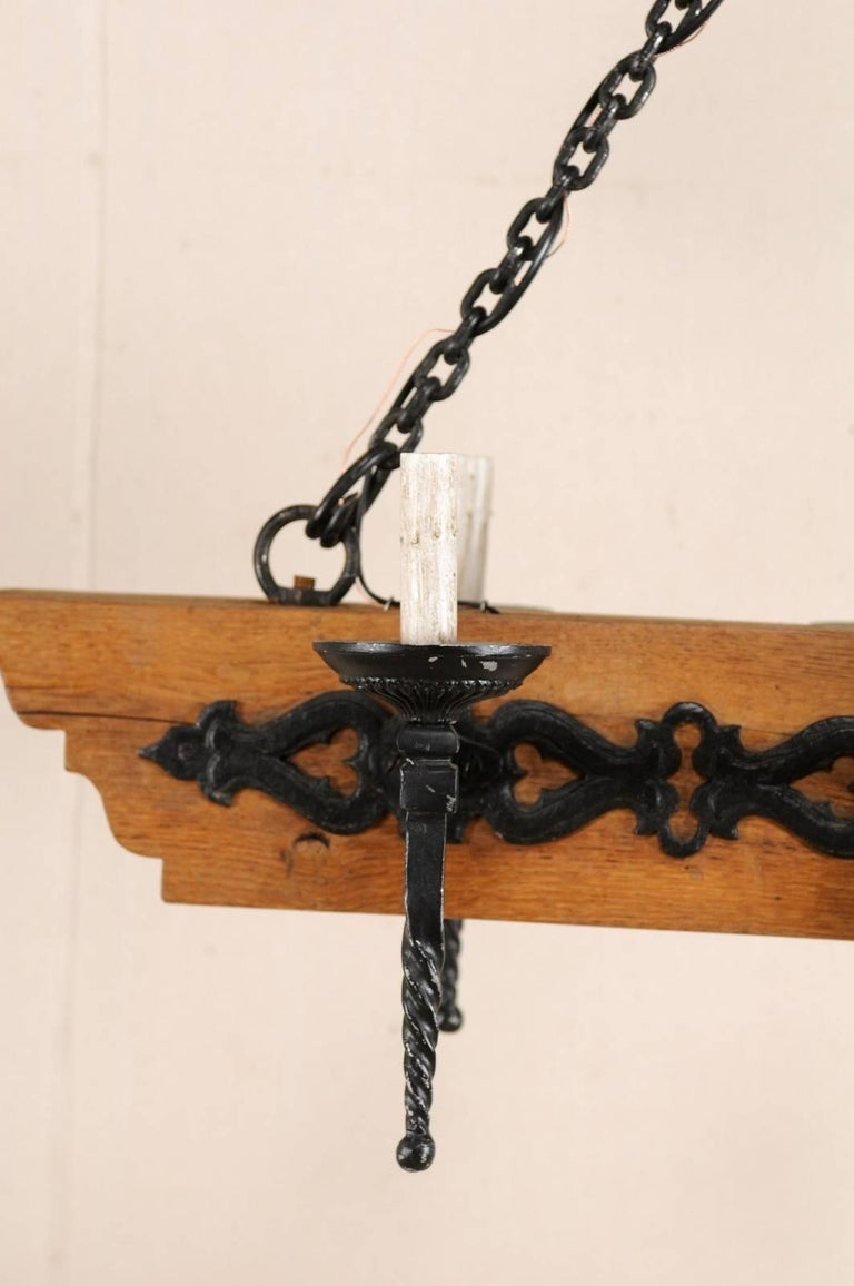 French Vintage Six-Light Wood and Ornate Iron Chandelier with Torch Style Arms For Sale 3