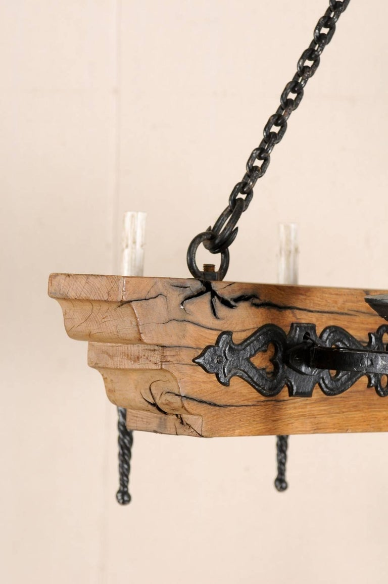 French Vintage Six-Light Wood and Ornate Iron Chandelier with Torch Style Arms For Sale 2