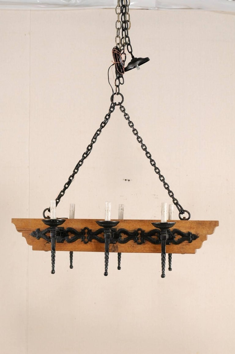 Carved French Vintage Six-Light Wood and Ornate Iron Chandelier with Torch Style Arms For Sale